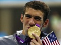 Phelps wins 100m butterfly for record 17th gold