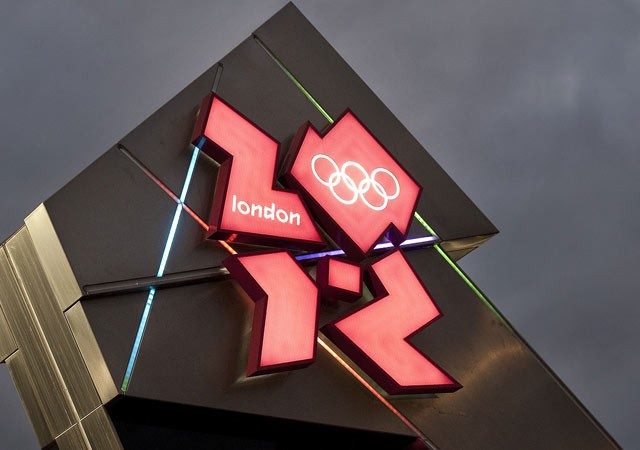 London Olympic watchdog member quits over Dow deal