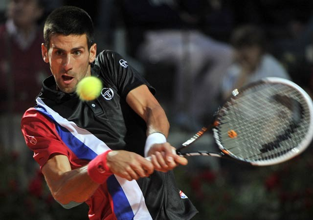 Djokovic eases past Federer to set up Nadal final