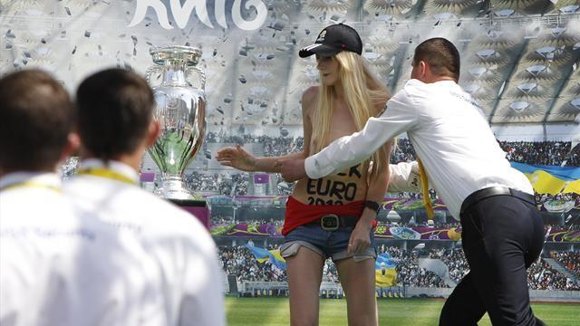 Topless Ukraine activist grabs Euro soccer cup