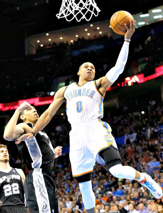 Oklahoma City Thunder guard Russell Westbrook (0) shoots in front of San Antonio Spurs guard Danny Green (4) in the first quarter of an NBA basketball game in Oklahoma City,