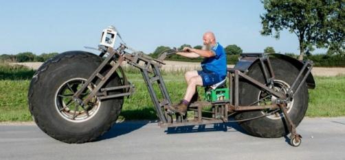 http://www.indiatimes.com/news/world/german-man-builds-the-world-s-heaviest-bike-that-weighs-a-massive-1-000-kg-260840.html