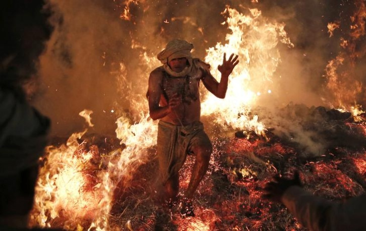 Hindu priest jumps out of a fire