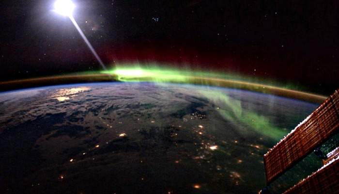this is how the northern lights look from outer space and