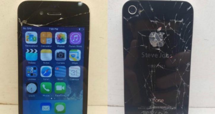 iphone 4s with steve jobs logo