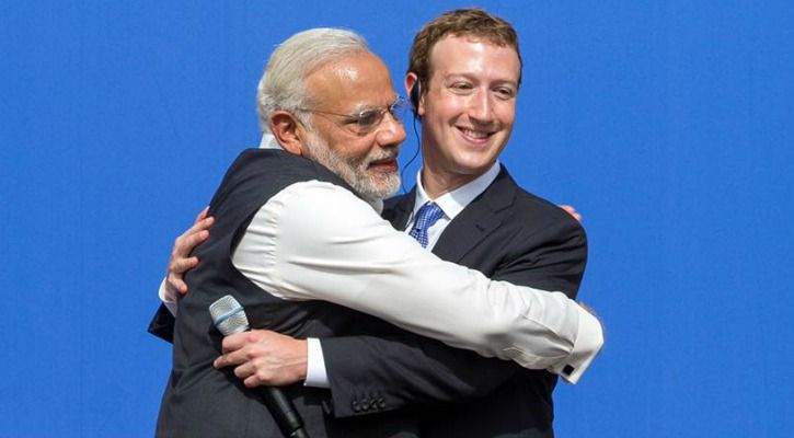 Mark Zuckerberg embraced by Narendra Modi