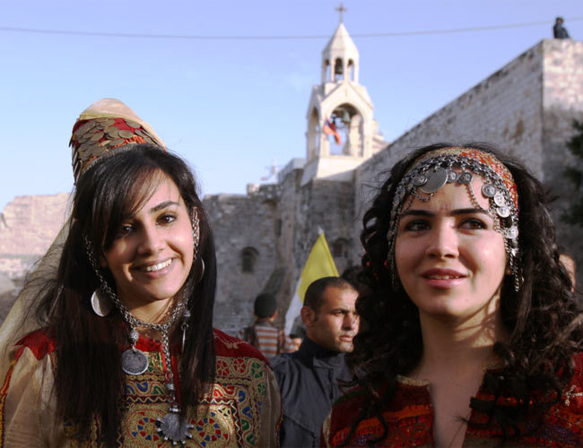 Tens of thousands of Christians were flocking to Bethlehem today to celebrate Christmas following a year of political upheaval and change across the Arab world. Text & Photo: AFP
