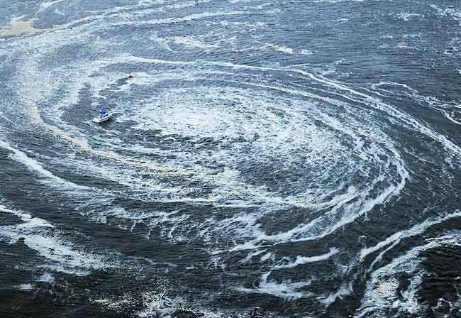 Tsunami swirls near a port in Oarai, Ibaraki Prefecture (state) after Japan was struck by a strong earthquake off its northeastern coast.