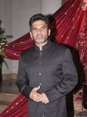 Suniel Shetty poses at the event.