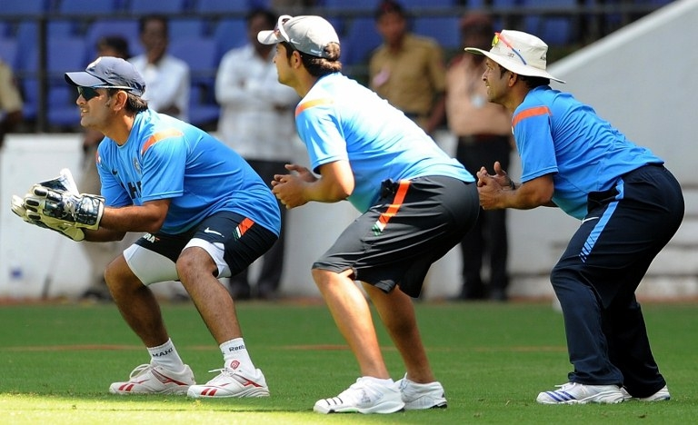 Indian cricketers Mahendra Singh Dhoni (L) Suresh Raina (C) and Sachin Tendulkar (R) take part in fielding practice during a training session at The Vidarbha Cricket Association Jamtha Stadium in Nagpur on October 27, 2009, on the eve of the second one day international (ODI) match between India and Australia.