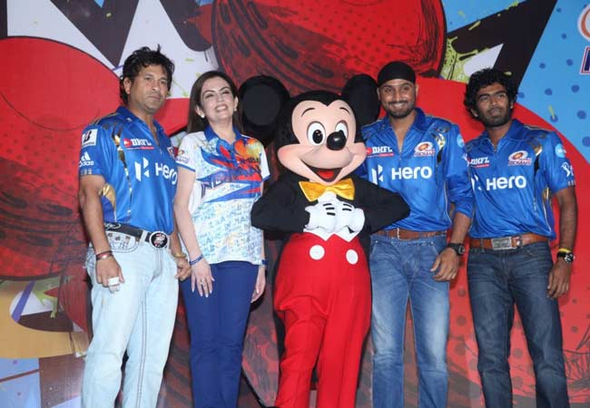 Nita Ambani, Sachin Tendulkar, Mumbai Indians skipper Harbhajan Singh and Lasith Malinga join Mickey Mouse during the unveiling  of a special collection of apparels, footgears, stationaries and toys.
