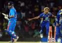 Sri Lankan cricketer Lasith Malinga (R)