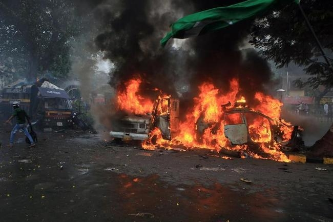 Vehicles set on fire by demonstrators