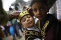 Boy hug as they leave Eid al-Fitr mass prayers at Kashmiri Takiya Jame mosque in Kathmandu