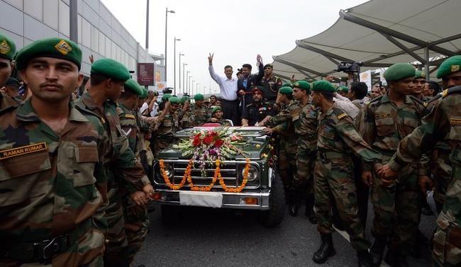 Indian army officials escort Vijay Kumar