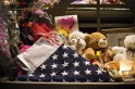 A folded United States flag is seen at a memorial for those killed in the massacre at Sandy Hook Elementary School in Sandy Hook, Connecticut