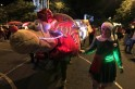 People dressed in costumes walk in Usaquen Park during Festival de Navidad celebrations in Bogota