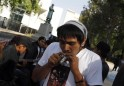 A man smokes marijuana during the 4th Marijuana Festival outside the Senate building in Mexico City