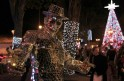 A man in a costume made out of mirrors poses in Usaquen Park in Bogota