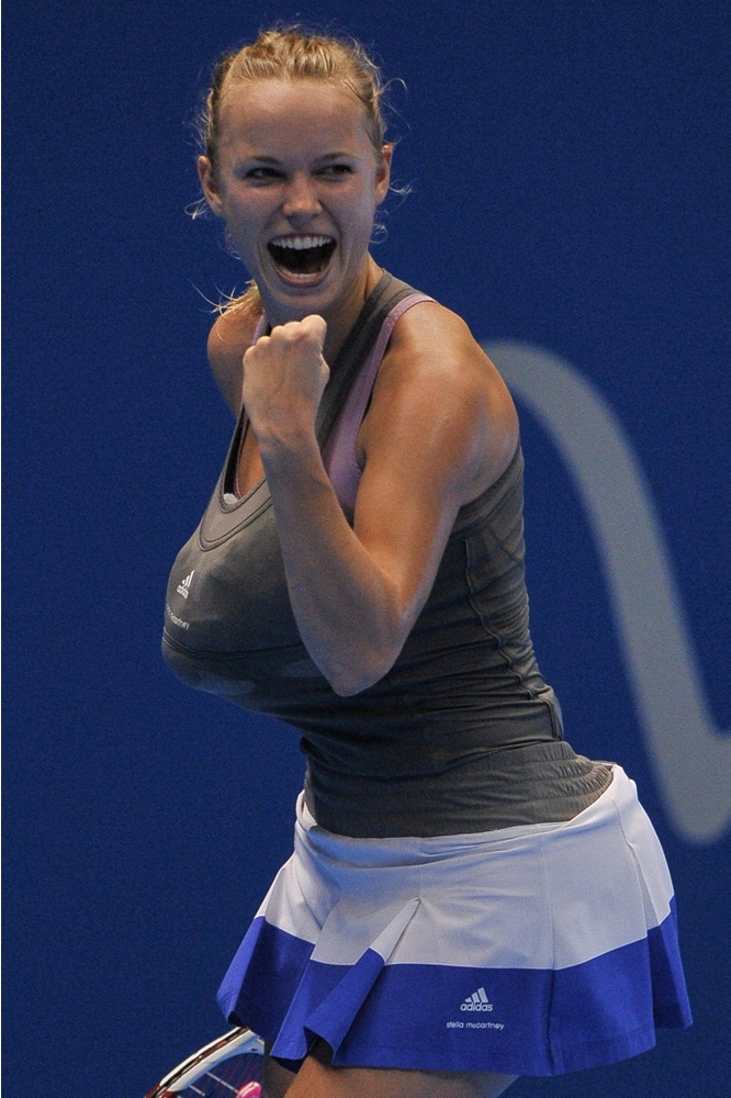Caroline Wozniacki rejoices after scoring a point while mimicking Serena Williams in Sao Paulo, Brazil. (Photo: AFP)