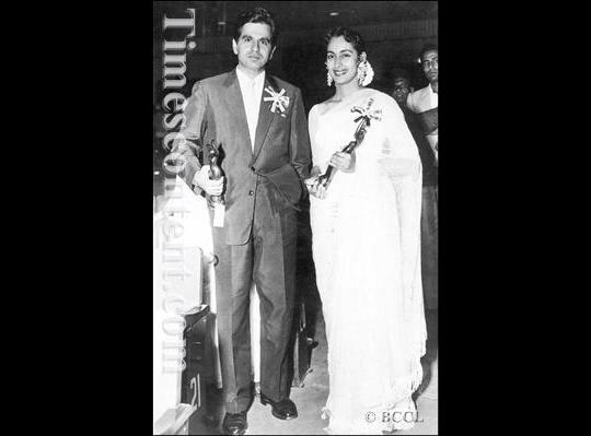 Dilip Kumar receives the Best Actor award for his performance in Hindi film 'Devdas' and actress Nutan, receives the Best Actress award for her role in Hindi film 'Seema' at the Filmfare Award function held in Bombay on May 5, 1957.