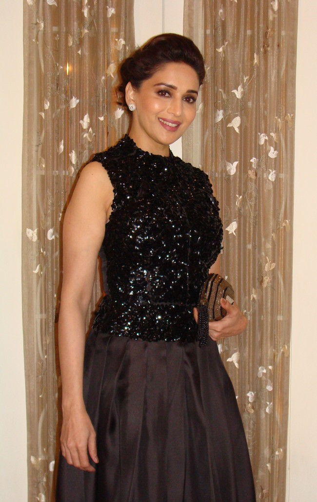Madhuri Dixit Nene wore a sleeveless black sequined Christian Dior ball gown with a crystal embellished Judith Leiber clutch