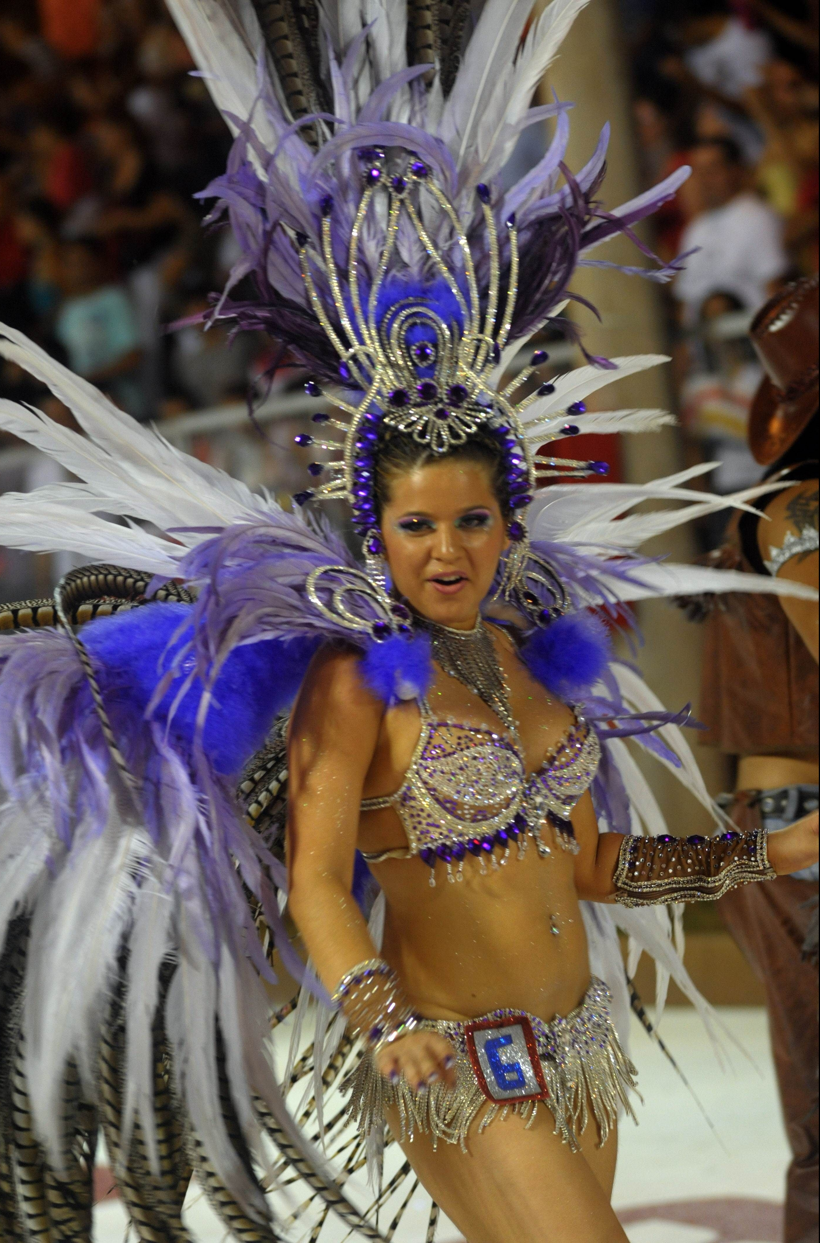 Dancers perform during carnival in Encarncion 375 km south of Asuncion. The 'Llamadas' is Paraguay's biggest carnival parade, in which 'comparsas,' groups of dancers and drummers compete.