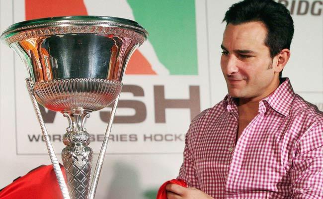 Saif Ali Khan takes a closer look at the World Series Hockey trophy in Mumbai.