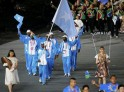 Somalia's flag bearer Zamzam Mohamed Farah holds the national flag as she leads the contingent in the athletes parade during the opening ceremony of the London 2012 Olympic Games