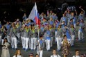 Slovenia's flag bearer Peter Kauzer holds the national flag as he leads the contingent in the athletes parade during the opening ceremony of the London 2012 Olympic Games
