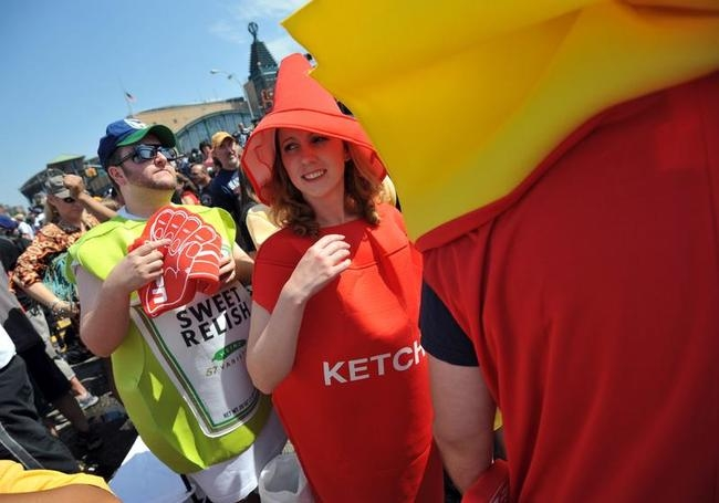 People dressed as condiments just before