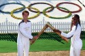 Legends carry Olympic Flame