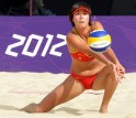 China's Zhang Xi plays a shot during her