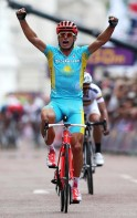 Kazakhstan's Alexandr Vinokurov celebrates as he wins the men's cycling road race to claim the gold medal at the London 2012 Olympic Games
