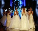 Models present wedding creations by Geraldina Sposa during a fashion show in Tirana