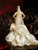A model presents a wedding creation by Geraldina Sposa during a fashion show in Tirana