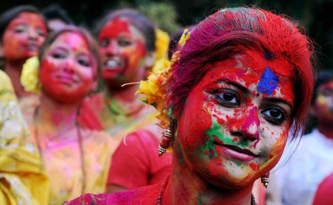 Students exchange aabir during Vasantotsav celebrations in Kolkata. Vasantotsav is celebrated in the rest of India as Holi.