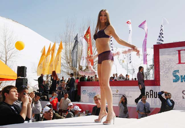 A model displays lingerie collection during the Ski and Fashion Festival 2012 at Le Refuge Terrace-Intercontinental Mzaar, Mount Lebanon.