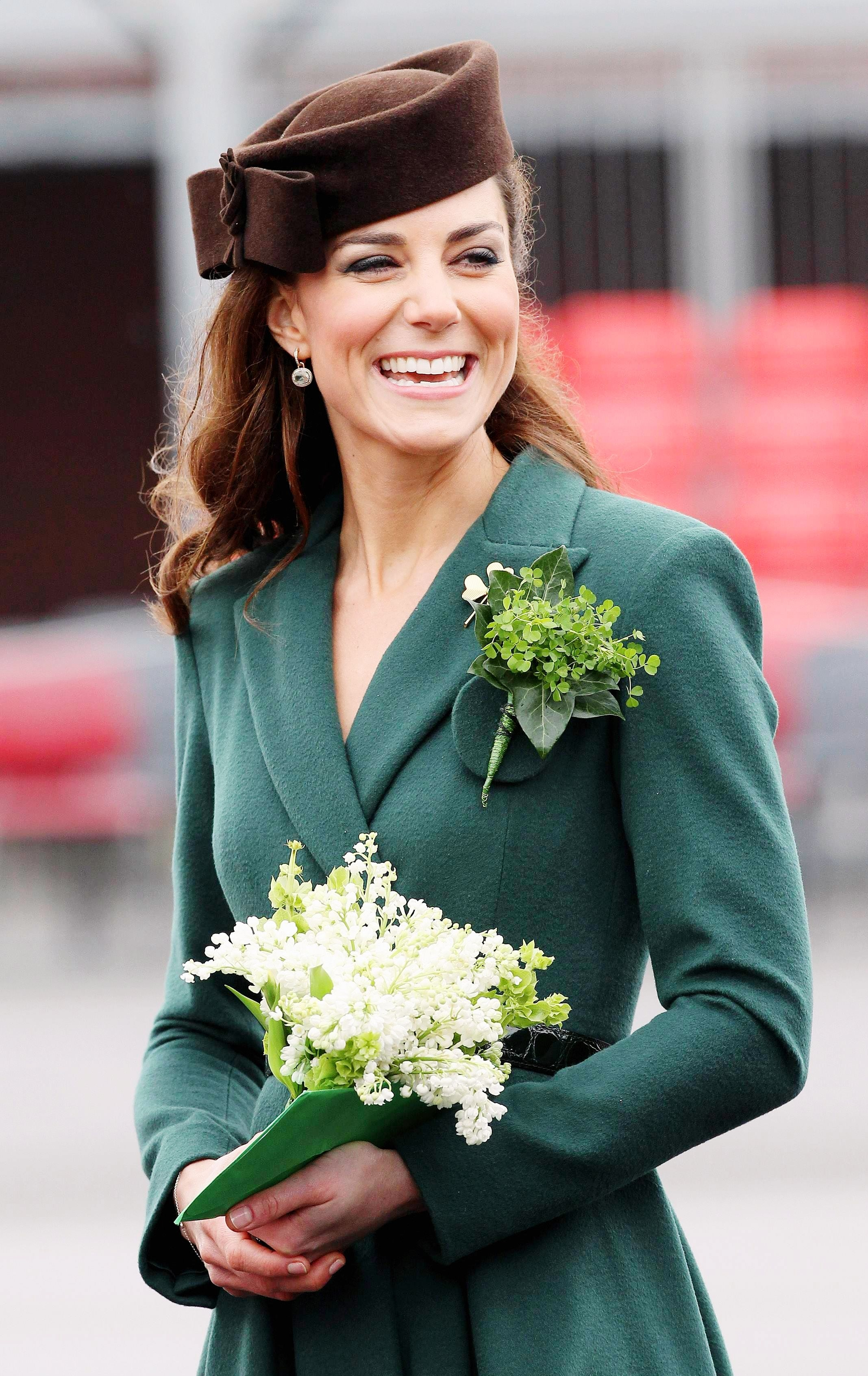 Duchess of Cambridge wears a shamrock during a visit to Aldershot Barracks in Aldershot.