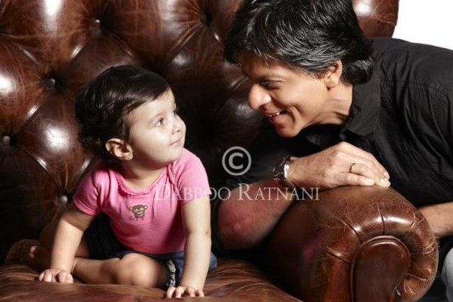 SRK in a cute and candid still with photographer Dabboo Ratnani's baby.