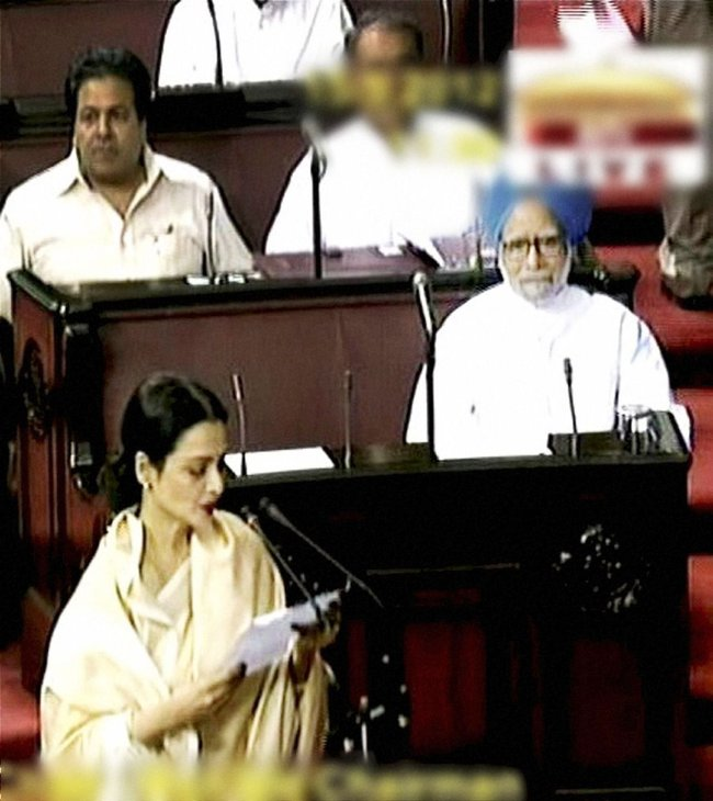 Bollywood actress Rekha taking oath as a Rajya Sabha member in New Delhi on Tuesday. Prime Minister Manmohan Singh is also seen in the picture.