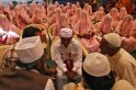 A Muslims groom speaks with a cleric and his marriage witnesses during a mass marriage ceremony in Ahmedabad
