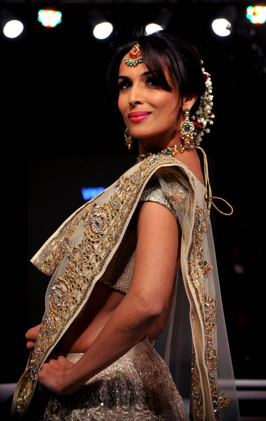 Malaika Arora Khan displays creations by designer Vikram Phadnis at the 8th edition of Seagram's Blenders Pride Fashion Tour 2012, in Mumbai, on 4th November.