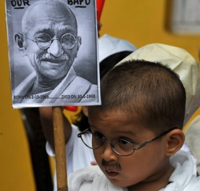 An Indian child dressed as Mahatma Gandhi takes part in rehearsals for Gandhi Jayanti celebrations in Siliguri