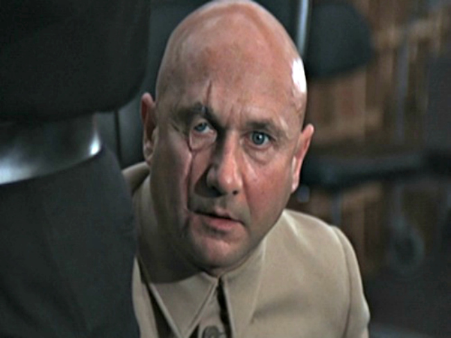 Blofeld: In Fleming's books itself the incorrigible Blofeld sounds like he'd be a better fit for a Potter novel where he can play some 'creature-who-must-not-be-named' rather than a treacherous villain Bond needs to take care of. He's described as a strange, chameleon-like man who can at one moment be huge and disinterested in sex (as he is in Thunderball) and at another have no earlobes and a syphilitic nose (as seen in You Only Live Twice). He's the father of all the other villains and the head of the evil Spectre organisation. He's grossly scarred, utterly deceitful, rich, ruthless and terrifyingly authoritarian. He's also the man who gave birth to Dr. Evil who in turn gave birth to Mini Me. But perhaps the scariest part about him is that he remains undefeated even today. Till date, he remains the only recurring villain in the Bond books and also one of the few to incur more psychological damage to James Bond than any of the others. After all, he is the villain who kills Bond's wife. Donald Pleasance probably did the best job of pulling off this role with the evil, cold and sarcastic vibe that fit perfectly with this character. And then there's that Mao suit. Downright terrifying is all we can say.