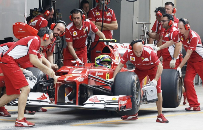 Ferrari driver Felipe Massa of Brazil is pushed back into the Ferrari pit garage during the qualifying session of the Formula One Indian Grand Prix at the Buddh International Circuit in Greater Noida on October 27, 2012. (Photo: AFP)