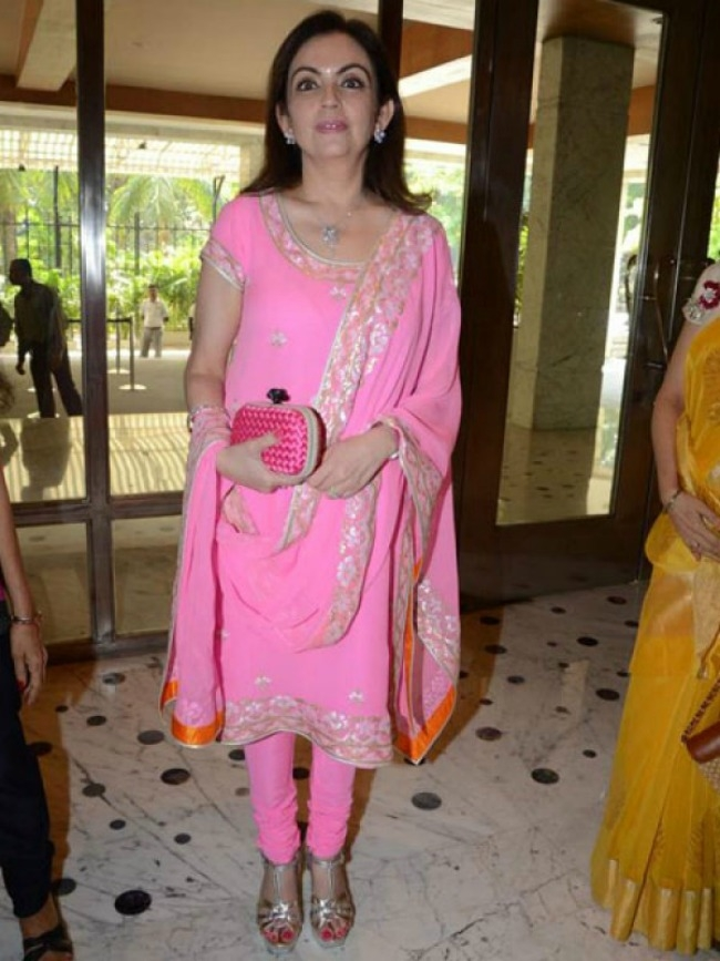 Nita Ambani with a Bottega Veneta clutch