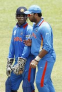 India's captain Mahendra Singh Dhoni talks to Yuvraj Singh ahead of the World Twenty20 cricket series in Colombo