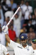 India's captain Dhoni holds a wicket in his hand as he celebrates after India won the match and the series against New Zealand on the fourth day of their second test cricket match in Bangalore