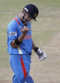 India's vice captain Gambhir looks at his fingers after the ball hits on his fingers during their warm up match against Sri Lanka  ahead of the World Twenty20 cricket series in Colombo